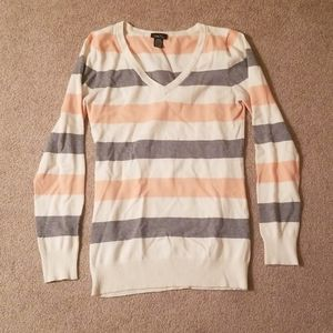 V-neck sweater with gray, peach, and cream stripes
